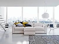 divano con chaise longue centrale